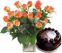 Boomrang  15 Long stem Roses in a Glass vase with Half Kg. Chocolate Truffle Cake.Noida Florist offers express delivery.
