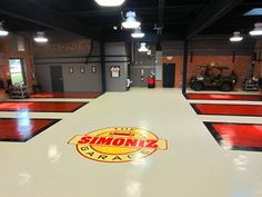 Auto Shop Floor displays an epoxy floor finish. Garage Loft, Garage Shop, Dream Garage, Garage Workshop, Shop With Living Quarters, Underground Garage, Restoration Shop, Tyre Shop, Garage Interior