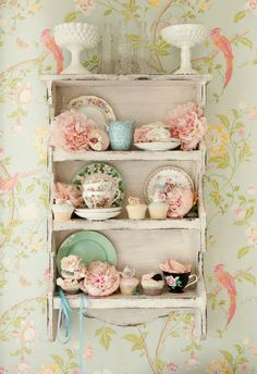 Pastels...chippy shelf, vintage dishes, pretty wallpaper   #milkglass #china #dishes #teacup #plate #shelf #wallpaper #shabby #chic #vintage #cottage #pastel #pretty #decor
