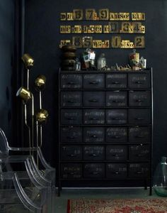 Black on black with vintage cabinet, brass MCM floor lamp and Louis ghost chair