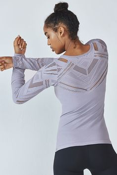 Watch this seamless, second-skin layer work its magic from the barre to the bar. Its breathable, open-knit jacquard design is both sexy and comfortable. Need we