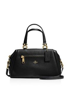 The new Primrose Satchel combines the capacious interior of a carryall with the graceful curves of a satchel. Crafted in richly pebbled leather, the convertible design has bright custom hardware for a bit of shine and protective feet on the bottom. Gold Handbags, Leather Satchel Handbags, Burberry Handbags, Coach Handbags, Fashion Handbags, Coach Bags, Burberry Bags, Coach Purses, Gucci