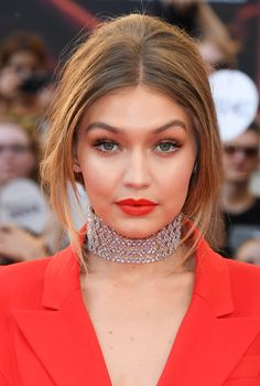 Maybelline girl Gigi Hadid stunned on the red carpet of the 2016 Much Music Awards. Makeup artist Patrick Ta used Dream Velvet Foundation to perfect Gigi's skin, adding Fit Me! Bronzer for a glow. To highlight, Ta applied Better Skin Concealer under the eyes in a shade two shades lighter than Hadid's foundation. For the eye look, Ta created a natural smoky eye using The Nudes eyeshadow palette. For more makeup ideas, click through to visit Maybelline Makeup Trends'.