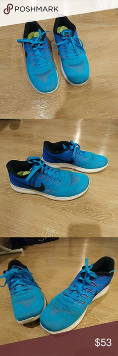 Nike Free RN Sneakers Nike Free RN sneakers. Beautiful bright blue color with pink underneath. Size 8.5. Nike Shoes