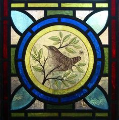 Painted stained glass wren roundel via Apollo Stained Glass.
