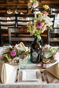 growler as a vase is such a fun idea for table decor! Jeff & Jewels photography captured this colorado wedding beautifully!