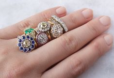 Impressive stack of vintage engagement rings!