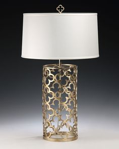 hand-wrought iron table lamp with antique silver leaf finish and round hardback fabric shade; table lamps
