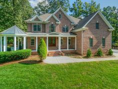 Full brick luxury home with wrap around, covered porch