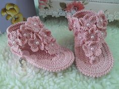 These nice sandals are simply adorable. They have got a slim strip joining the… Baby Girl Sandals, Crochet Baby Sandals, Booties Crochet, Baby Girl Crochet, Crochet Baby Clothes, Crochet Shoes, Baby Girl Shoes, Crochet Slippers, Crochet For Kids