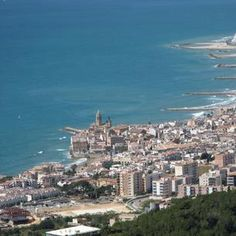 Places to see in ( Sitges - Spain ) Sitges is a coastal town in Spain's Catalonia region, southwest of Barcelona. Backed by the mountainous Parc Natural del . Sitges, Spanish Towns, Spanish Art, Moving To Barcelona, Barcelona Spain, One Day Tour, Excursion, Ferrat, Beach Town