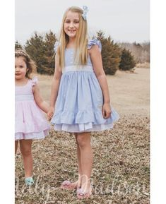 #easterdress #easter #seersucker #ruffles #bows #alexandra #churchdress #sisterset #familyphotos #southernbelle #southern #twirls #girlsfashion #fashion #madeintheusa #americanmade #babyblue #blue      High volume ruffled hem dress Invisible zip closure in back, tie sash for perfect fit...