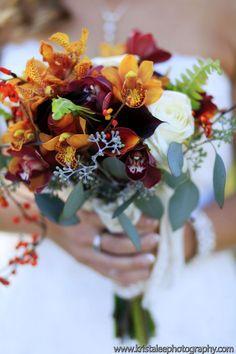 Orchid, calla, garden rose and seeded eucalyptus bouquet