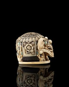 An embellished ivory netsuke of an elephant