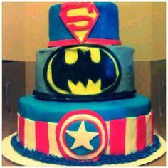 Superhero cake. DC and Marvel comics. Superman (real strawberry cake), Batman (lemon cake), Captain America (chocolate cake) all covered in my vanilla buttercream and fondant
