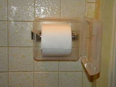 """Purchased a $1.50 tupperware type container with a hinged lid. Using an x-acto knife, cut out an area of the bottom that would fit over the tp holder.  Then used double-sided sticky tape to secure it to the wall and then inserted the tp.  Just open the """"door"""" to access it and KEEP KITTIES OUT!"""