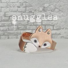 Wrap Around Fox Ring by WeldedHeart on Etsy, $70.00 A bit expensive in mho, but its cute enough to look at.