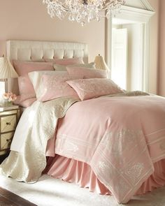 .pink bedding and chandelier