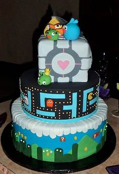 Angry Birds, Portal, Pac Man and Mario all represented on this great cake from A Piece of Cake Bakery!