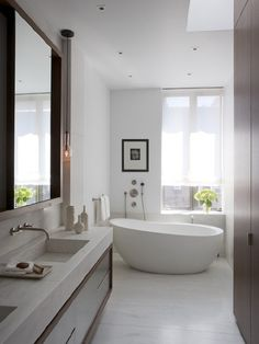 Bathroom. Nice Design Ideas of Bathrooms Tiling. Cool Square Shape White Floor Tiling Come With Free Standing Bathtubs And White Wall Color Plus Glass Window Along With Wall Mount White Wooden Double Vanities Also Undermount Bath Sinks Plus Wall Mount Faucets And Also Large Wall Mirror With Wooden Frames Also Clear Downlights And Flowers Vase Plus White Blinds Also Towel Bars And Hand Shower And Also Hanging Lamp. Tiling A Bathroom Ideas
