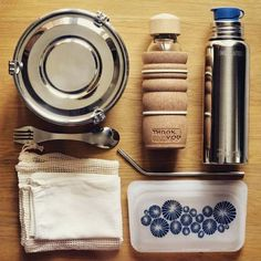 Zero waste on the go essentials - a reusable stasher ziploc bag, stainless steel straw, water bottle, cloth produce bags, and more!
