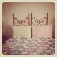 soft coloured quilt bed-spread