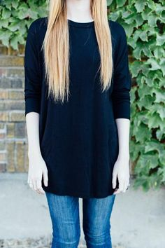 This black tee is very loose and relaxed. It has a great high neckline and 3/4 length sleeves. 95% Rayon, 5% Spandex