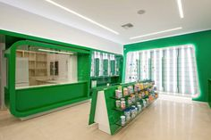 Health drugs store display furniture for interior design by green color wood cabinet and tempered glass shelves Pharmacy Design, Retail Design, Tenerife, Outdoor Furniture Stores, Tempered Glass Shelves, Shop Interior Design, Store Design, Display Shelves, Display Wall