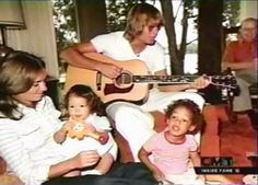 John Playing His Music To A Captive Audience - Wife Annie & Children Anna Kate & Zak