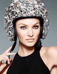 Supermodel Candice Swanepoel features in our latest campaign as an action woman - sleek, confident and accessorised with dazzling crystallised sporting gear including a motorcycle helmet, dumb bells and skiing goggles.