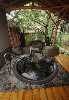 I f you don't have a tub already, consider adding a sunken hot tub into your backyard with a deck of natural stone, tall grasses, and outdoor curtains for ...