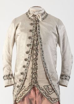 3-piece suit, 1780s. Cream silk with floral silk embroidery, embroidered buttons; breeches: pink silk satin.