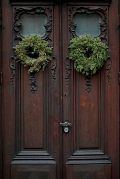 Old world door decorated for Christmas