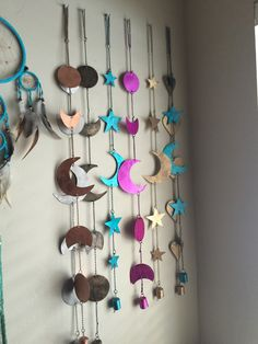 This beautiful piece represents all of the phases of the moon. Each is made from metal, and polished with a shimmering gold (or various other colors) Hangs arou
