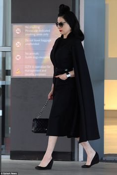 Repeat: Burlesque queen Dita Von Teese was spotted wearing the exact same all-black ensemb...