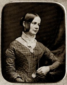 1845, lady with great brooch, reading glass and different hair braiding on side....woven hair.....