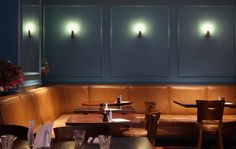 contemporary club chic with victorian charm relaxed seating area cast bronze wall lights and distressed leather seating