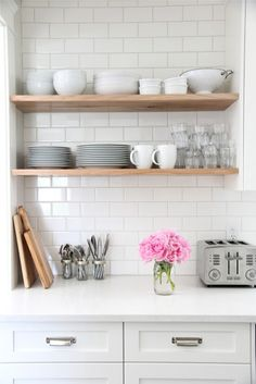 Not big on the subway tiles but I love the wood shelves!