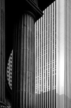 Peristyle and Standard Oil Building: Edward Durell Stones Standard Oil Building (now the Aon Center) is framed by the Peristyle columns in Millennium Park- by Bob Segal. Astounding Geometry