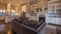Built-in shelves flank an elegant fireplace. Plan B, a new townhome built by Fisher Homes of Texas. The Fisher Estates at Oak Forest community. Houston, TX.