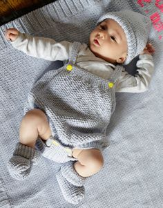 Adorable knit baby clothes & blanket.