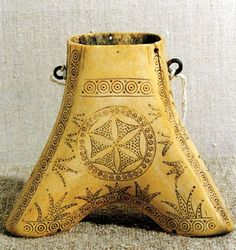 A nineteenth-century powder flask from Western Ukraine with the symbol of Perun, the pagan god of thunder