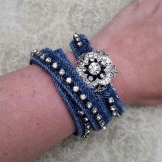 These 2 denim bracelets were made from jeans. The rhinestones were hand sewn onto the bracelets. One bracelet is a wrap around, the other has a pretty rhinestone brooch on it. These bracelets are sold together. #buynow for $32.50