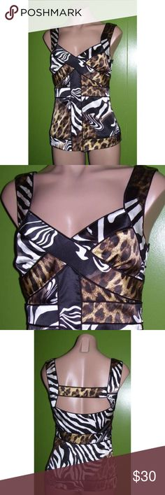 """New Cache Animal Print Silk Tank Blouse Top XS Cache Top  Size XS  chest - 30"""" waist: 27"""" total length: 23"""" ~ from back strap to bottom of hem - (approx)  95% Silk & 5% Spandex  Lining - 95% Polyester & 5% Spandex  Black/Beige/Brown/White  Hidden side zipper with hook & eye closure  New with the tag Cache Tops Blouses"""