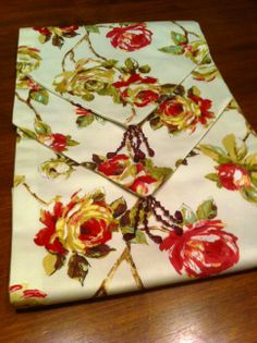 """""""Vintage Rose"""" this is a classic beautiful fabric with beaded detail on the tail.."""