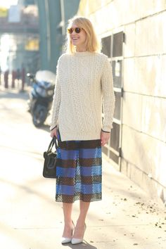 Indre Rockefeller in sheer stripes and a cozy Winter sweater. #Streetstyle at Paris Fashion Week #pfw