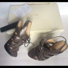 Coach Platform Leather SANDALNEW Never Worn✨ Brand new in original box w/card. Coach platform Pewter metallic Leather oxford/bootie Sandal. Has laces with metal tips and Black Wooden stacked Heel. Very on trend for this season. A year round dressy or casual heel. Originally $320. Trade value higherFLASH SALE ENDS 11/5 Coach Shoes Platforms