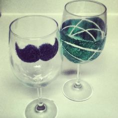 DIY glitter wine glass. green one done with rubber bands and then the classic mustache glass of course (: simply use mod podge and glitter and create your designs and using tape, rubber bands ect will help as guides if you'd like