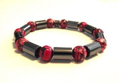 Delightful men's beaded bracelet showcasing the colors red, gray and white Designed by Audrey.  A mix of chunky hematite tube beads and round red mosaic jasper beads mark the awesome contrasting style