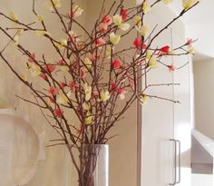 Tree branches with tissue paper flowers